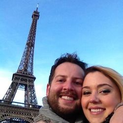 Tyler Barnett and Jenna Watson at the Eiffel Tower in Paris, France after their engagement.