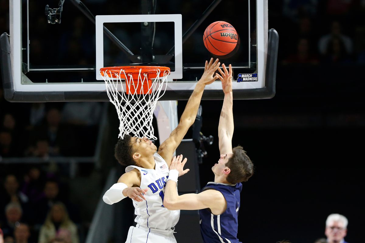 Mar 19, 2016; Providence, RI, USA; Yale Bulldogs guard Anthony Dallier (1) drives against Duke Blue Devils guard Derryck Thornton (12) during the second half of a second round game of the 2016 NCAA Tournament at Dunkin Donuts Center.