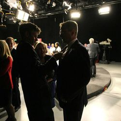 Doug Owens has his microphone adjusted following a debate Tuesday, Oct. 14, 2014, with Mia Love at the KUED studios in Salt Lake City. Owens and Love are running for the 4th District congressional seat.