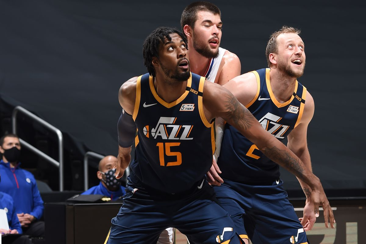 Derrick Favors #15 and Joe Ingles #2 of the Utah Jazz fight for position against Ivica Zubac #40 of the LA Clippers during a preseason game on December 17, 2020 at STAPLES Center in Los Angeles, California.