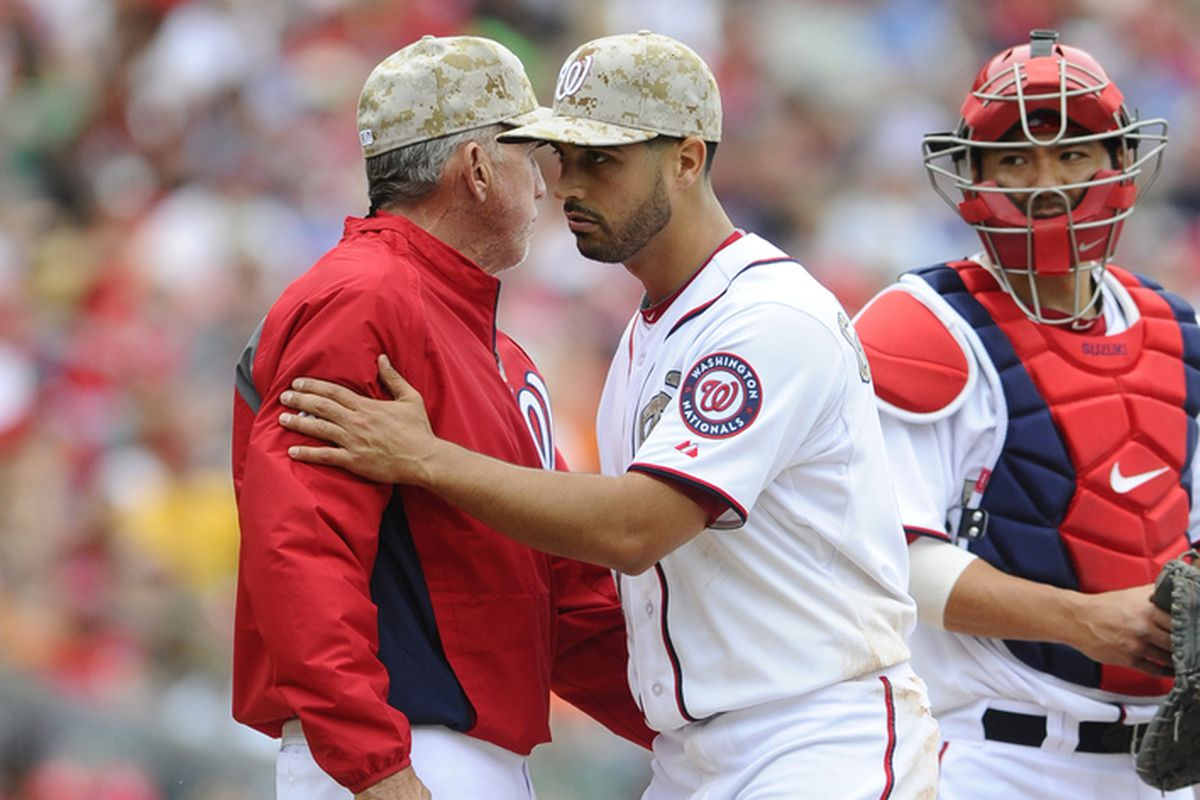 May 27, 2013; Washington, DC, USA; Washington Nationals manager Davey Johnson (left) removes starting pitcher Gio Gonzalez (47) during the sixth inning at Nationals Park.