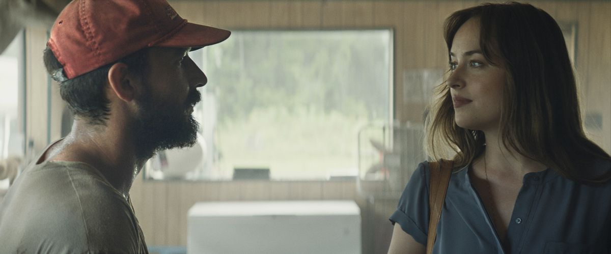 """Tyler (Shia LaBeouf) and Eleanor (Dakota Johnson) strike up an unlikely relationship in """"The Peanut Butter Falcon."""""""