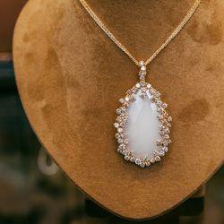 <b>Suzanne Kalan</b> rose gold, diamond and moonstone necklace, $12,000.