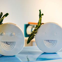 Decorate with a few small unexpected accents, like smiley-face ceramics.