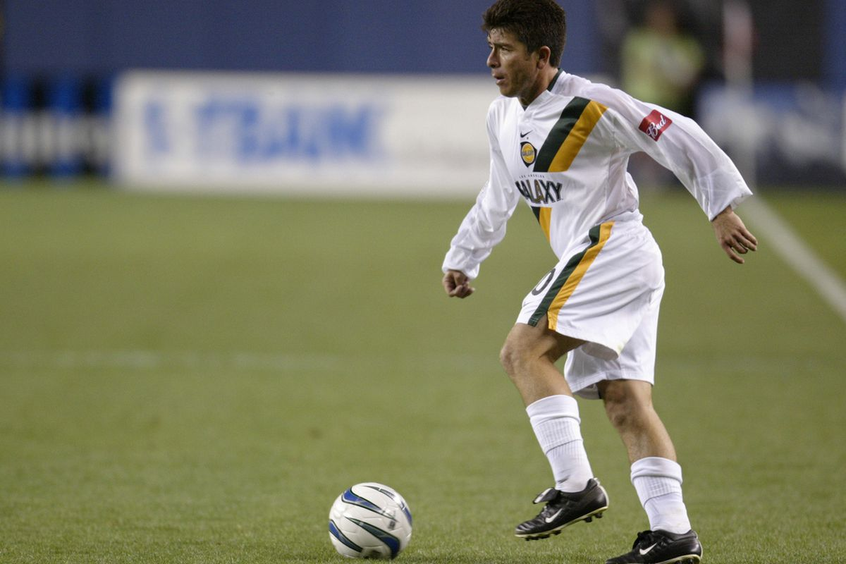 DENVER - JUNE 25: Midfielder Mauricio Cienfuegos #10 of the Los Angeles Galaxy dribbles the ball against the Colorado Rapids during the MLS game at Invesco Field at Mile High on June 25, 2003 in Denver, Colorado. The game ended in a 2-2 tie.