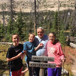 Utahn Robin Phillips in Christmas Meadows, Utah, with his grandchildren. The Phillips family have been coming to Christmas Meadows for five generations.