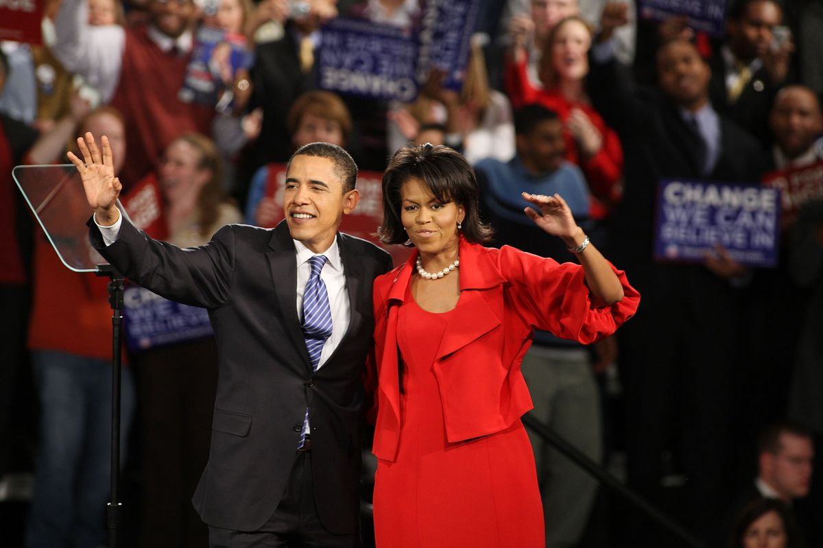 Barack Obama and his wife Michelle take the stage at the Hyatt Hotel February 5, 2008 in Chicago.