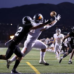 Corner Canyon's Zach Hale defends Skyridge's Teagen Calton on a pass during a high school football game at Corner Canyon in Draper on Friday, Sept. 24, 2021. Corner Canyon won 38-23.
