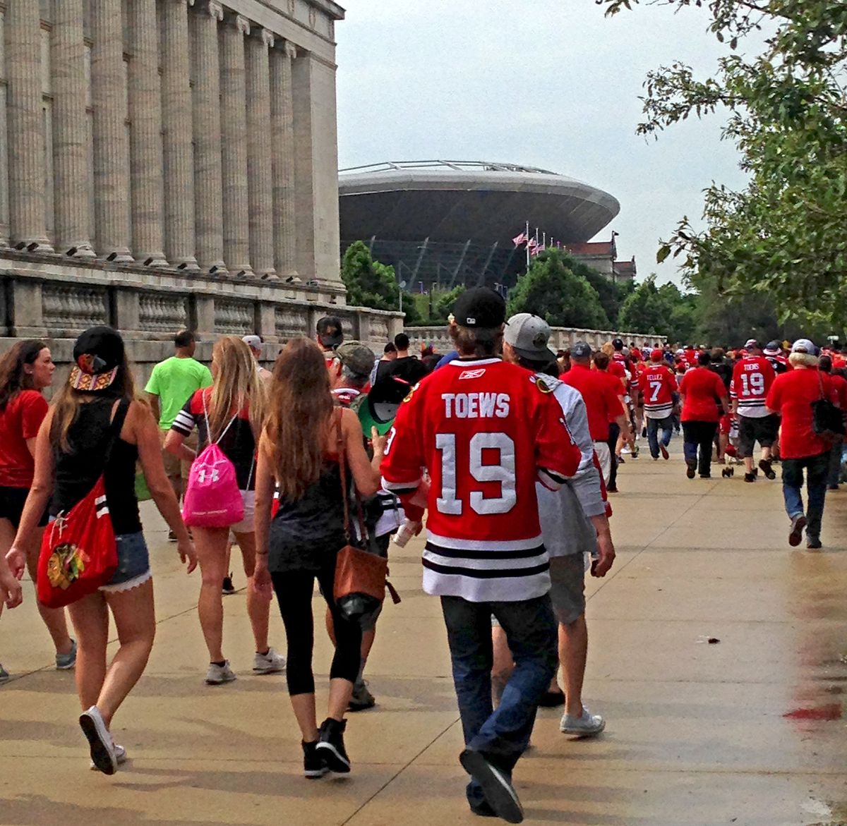 After the rains subsided, the crowd begins heading toward Soldier Field. | Jordyn Holman/For the Sun-Times