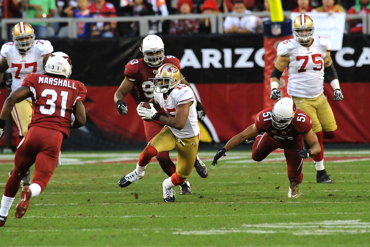 GLENDALE, AZ - DECEMBER 11:  Michael Crabtree #15 of the San Francisco 49ers runs with the ball against the Arizona Cardinals at University of Phoenix Stadium on December 11, 2011 in Glendale, Arizona.  (Photo by Norm Hall/Getty Images)