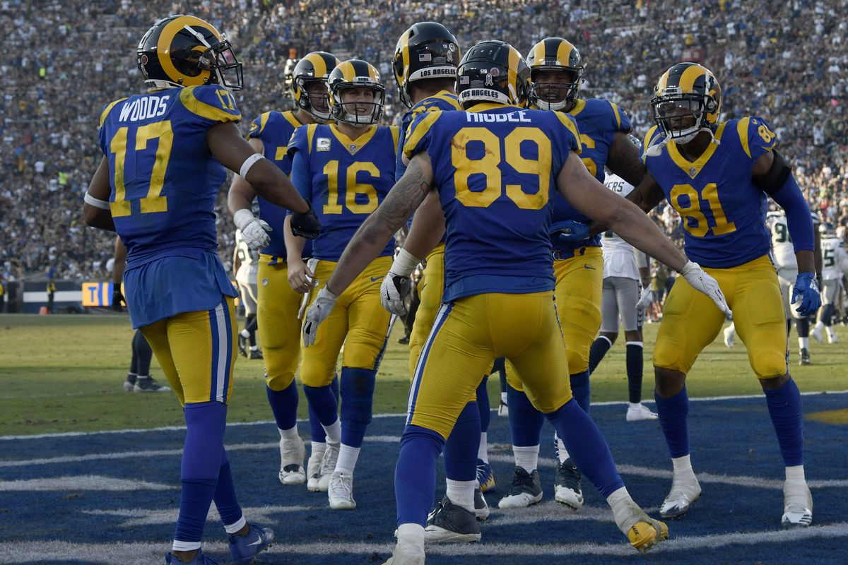 Members of the Los Angeles Rams' offense celebrate after TE Tyler Higbee scores a touchdown against the Seattle Seahawks, Nov. 11, 2018.