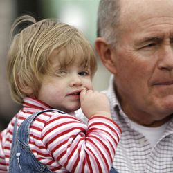 Clara Lewis'  father Grant Taylor holds her daughter Michaela who was also in the accident and wait for her return home from the hospital in Centerville  Thursday, Dec. 29, 2011. Clara Lewis was severely injured in mid-November when her vehicle was struck by a FrontRunner train in Kaysville at a crossing.