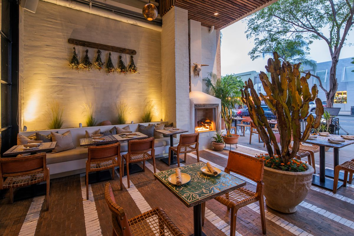 Mírame's outdoor patio with cactus, tables, and tiled floors.