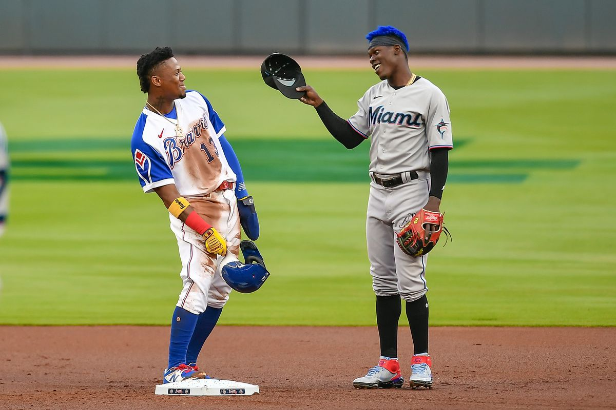 Atlanta right fielder Ronald Acuna Jr. (13) and Miami second baseman Jazz Chisholm Jr. (2) share a moment after Acuna stole second base during the MLB game between the Miami Marlins and the Atlanta Braves