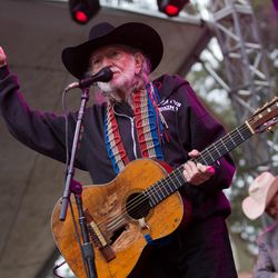 Willie Nelson wins for best guitar strap and most f'd up guitar.