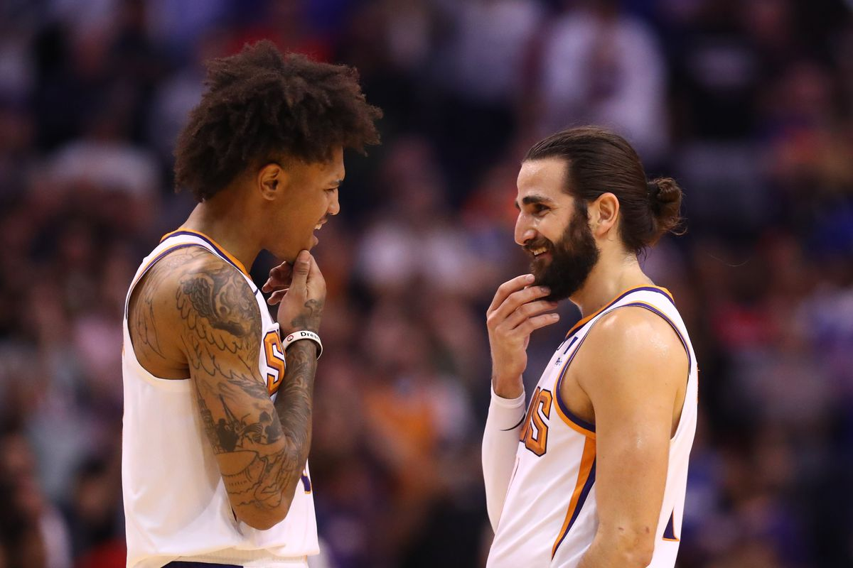 Phoenix Suns foreword Kelly Oubre Jr. celebrates with guard Ricky Rubio against the Philadelphia 76ers in the closing seconds of the game at Talking Stick Resort Arena.