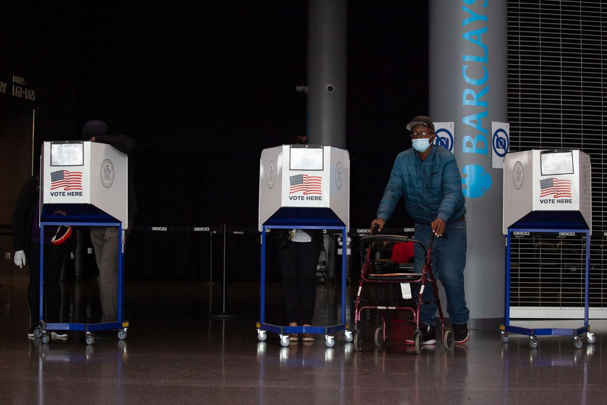 People cast their ballots in the Barclays Center on the first day of early voting, Oct. 24, 2020.