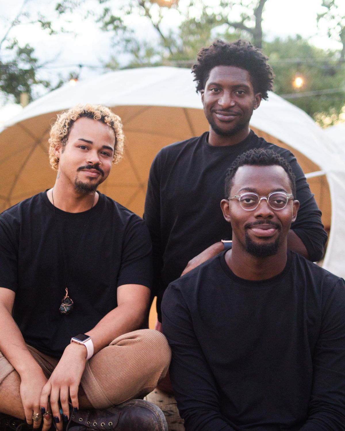 East Eats founders Kwaku Osei-Bonsu, Lloyd Talley, and Nigel Fyvie outside the outdoor domes at their restaurant