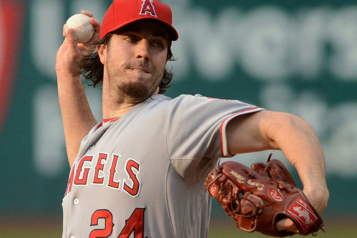 July 3, 2012; Cleveland, OH USA: Los Angeles Angels starting pitcher Dan Haren (24) throws a pitch against the Cleveland Indians during the game at Progressive Field.  Mandatory Credit: Eric P. Mull-USPRESSWIRE