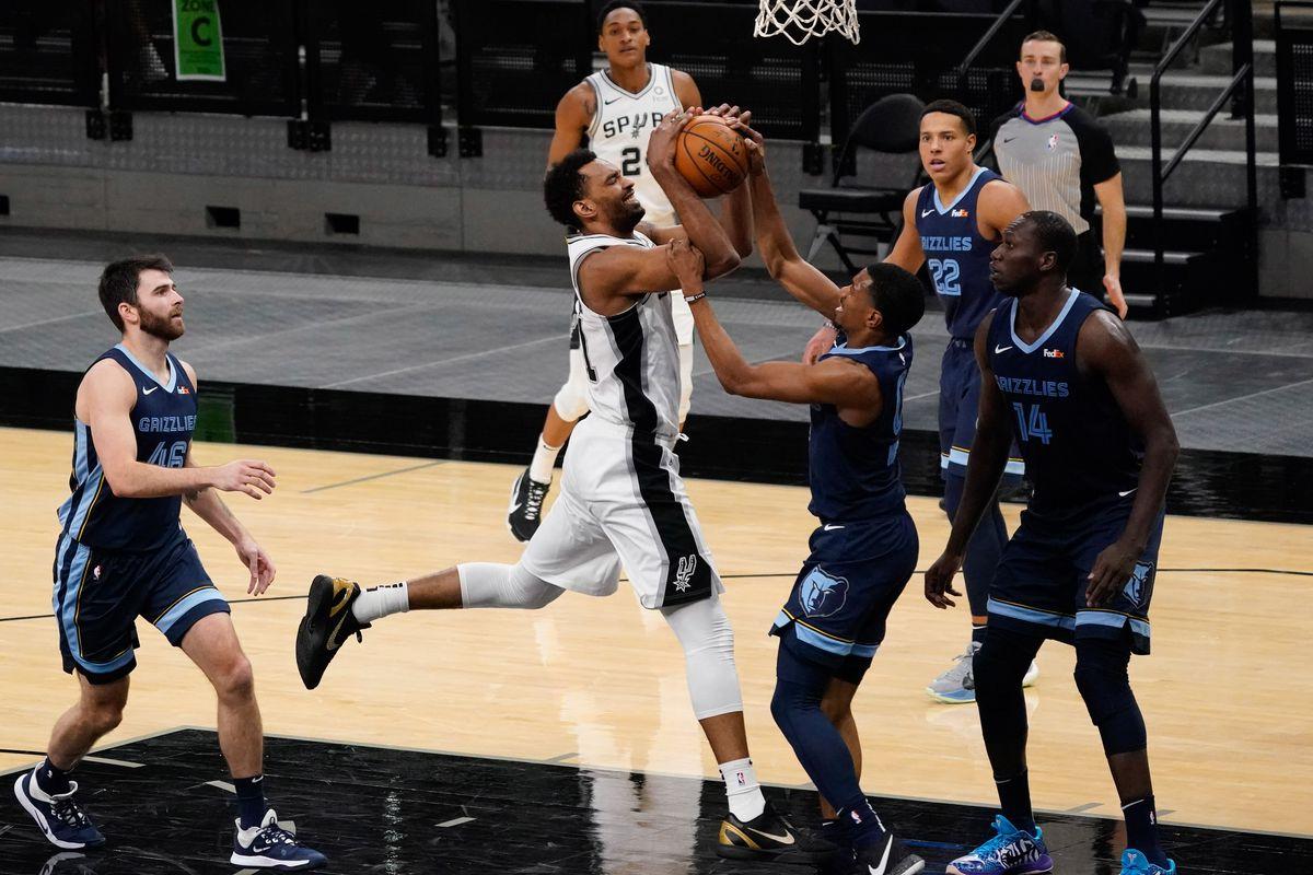 San Antonio Spurs forward Trey Lyles (41) shoots over Memphis Grizzlies guard De'Anthony Melton (0) in the fourth quarter at AT&T Center.