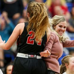 Grantsville's Maison White (24) celebrates with head coach Megan Vera after the first half of the 3A girls basketball semifinal game against the Judge Memorial Bulldogs at the Lifetime Activities Center in Taylorsville on Friday, Feb. 21, 2020.