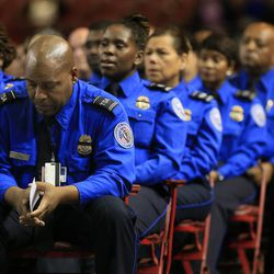 A Transportation Security Administration officer bows his head during the public memorial service for slain TSA officer Gerardo Hernandez, Tuesday, Nov. 12, 2013, in Los Angeles. Hernandez was the first TSA officer killed in the line of duty when a gunman pulled a rifle from a bag and shot the 39-year-old father of two on Nov. 1, at Los Angeles International Airport. Two TSA officers and a teacher were injured before airport police wounded the gunman, Paul Ciancia.