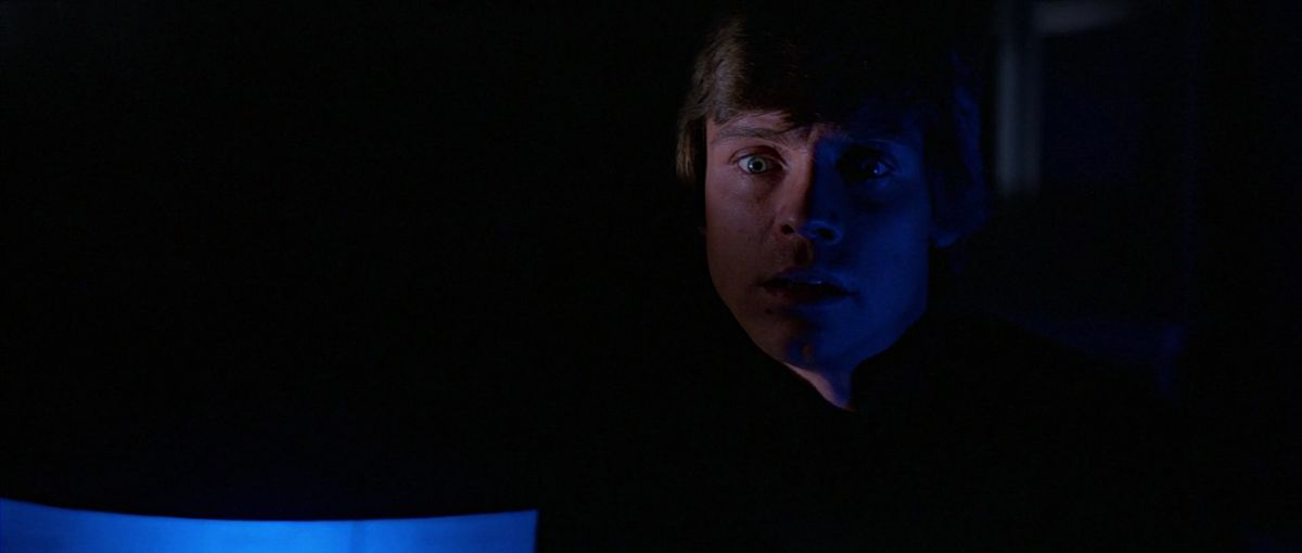 luke skywalker stands in the shadows of the death star as he watches the emperor hurt darth vader