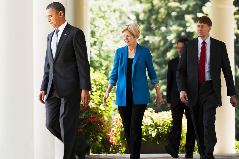 President Barack Obama walking to the White House Rose Garden followed by Elizabeth Warren and Richard Cordray in 2011.