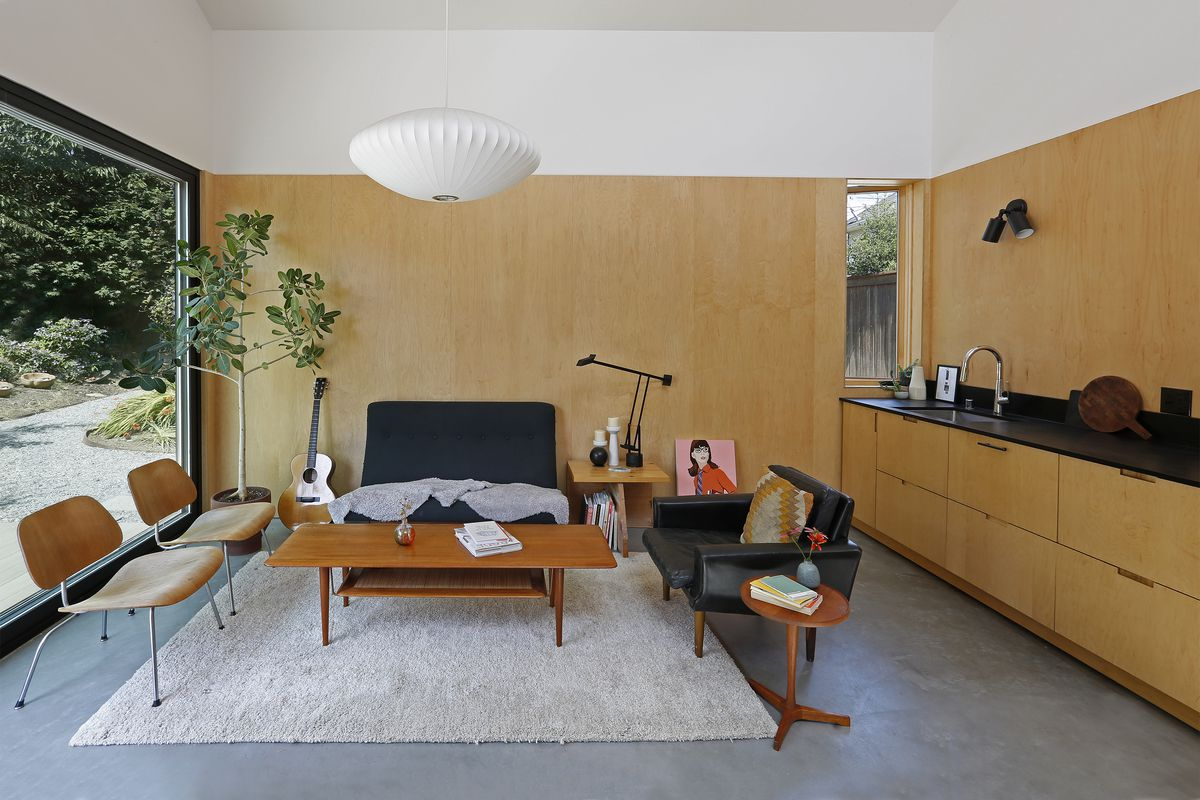 Living room with seating surrounding a wooden coffee table.