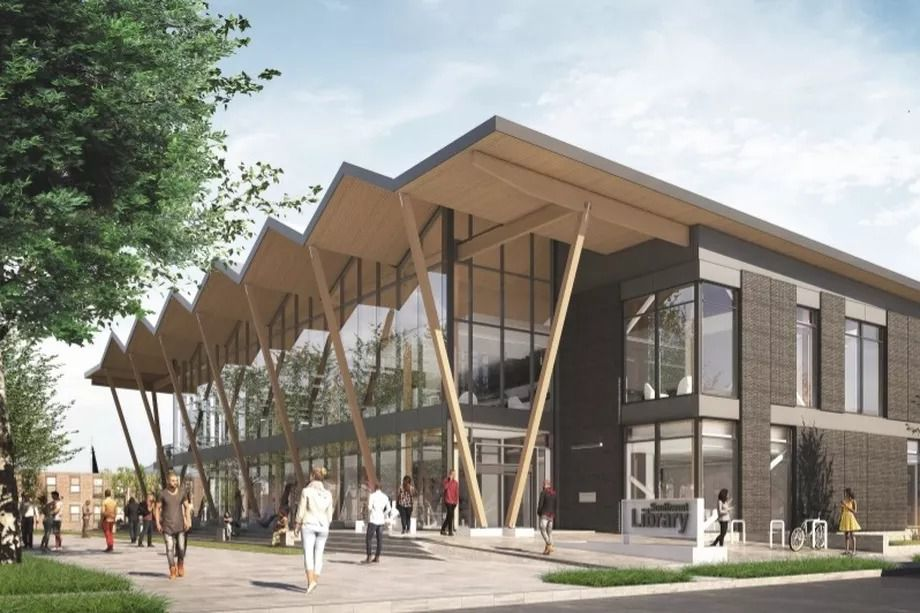 A rendering of the planned Southwest Library project at 900 Wesley Place SW, featuring diagonal roof supports and glass siding.