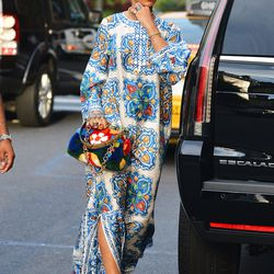 May 29th: Rihanna goes to dinner with Naomi Campbell at Emilio's Ballato in NYC, wearing a Dolce & Gabbana caftan, Stella McCartney creepers, a furry clutch, and hair jewels.