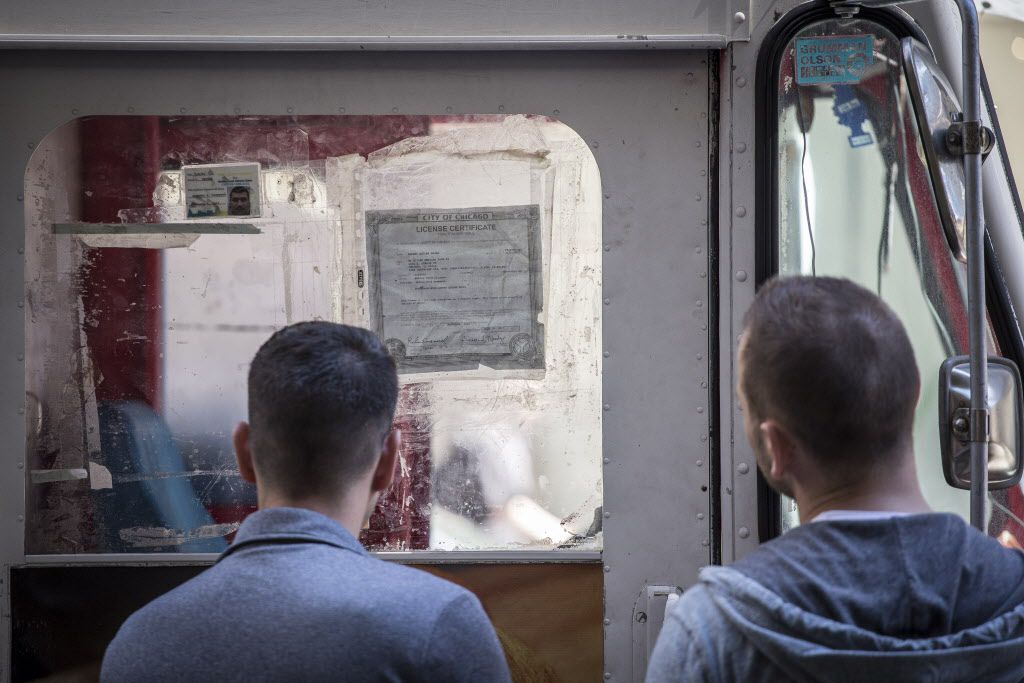 City inspectors check licenses of food trucks on Clark Street in the Loop. | Rich Hein / Sun-Times