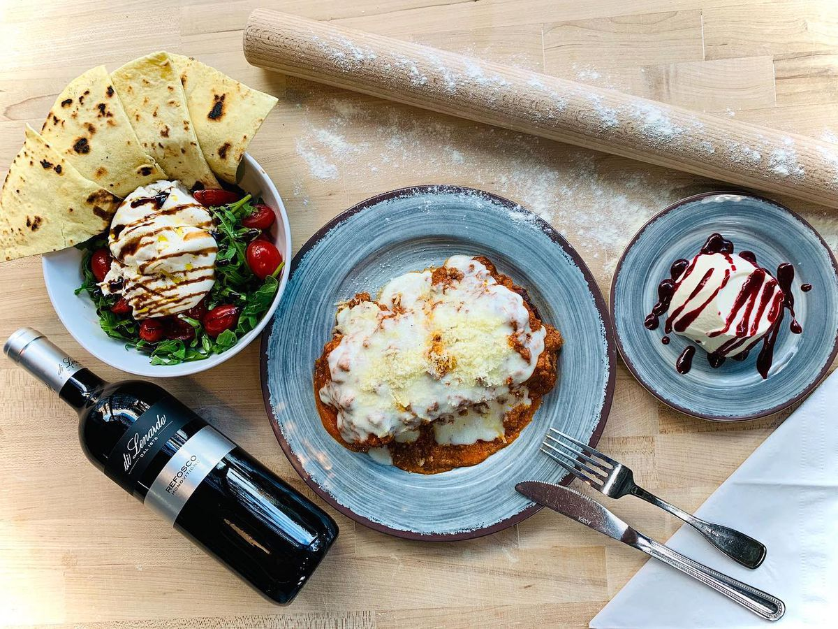A dinner box for two from Italian Homemade Company, which comes with pasta, salad, dessert, and wine