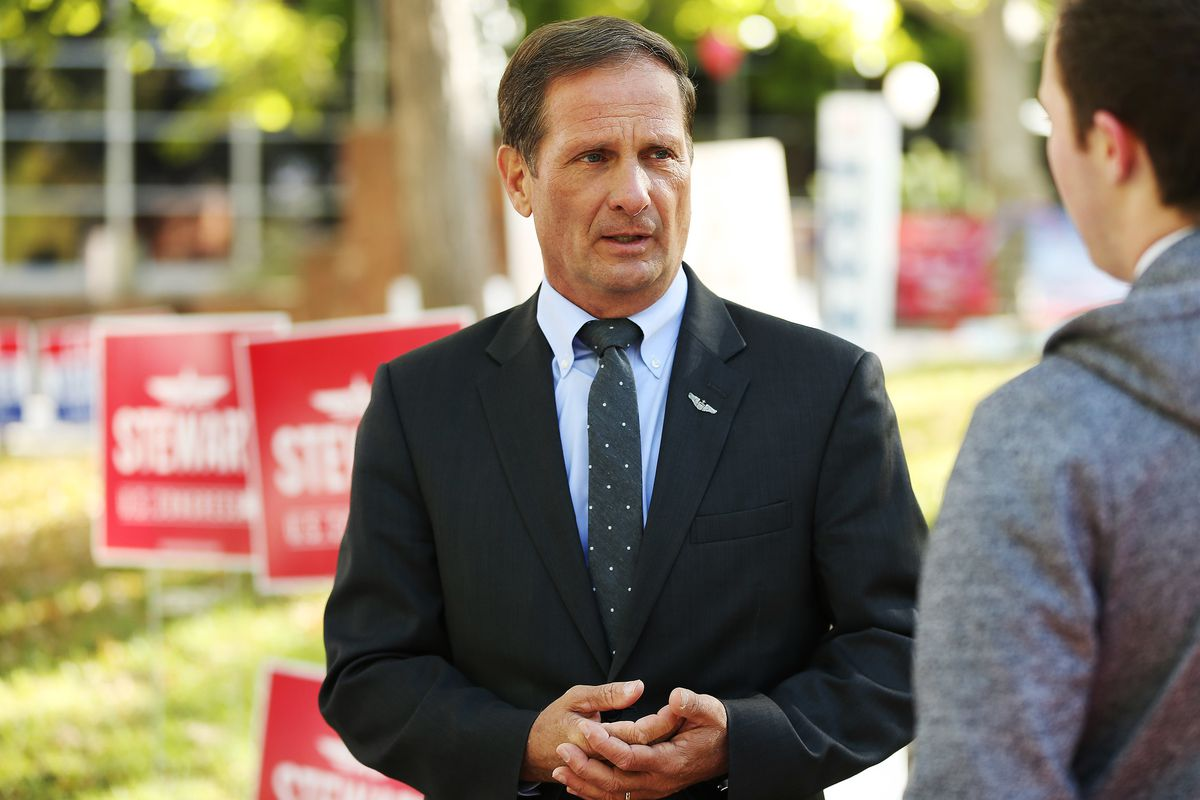 Rep. Chris Stewart, R-Utah, talks with a student while campaigning at the University of Utah in Salt Lake City on Oct 16, 2018.