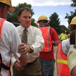 Lt. Gov. Gary Herbert greets volunteers who were cleaning up at the scene of a deadly mudslide in the Island area of Logan in July.