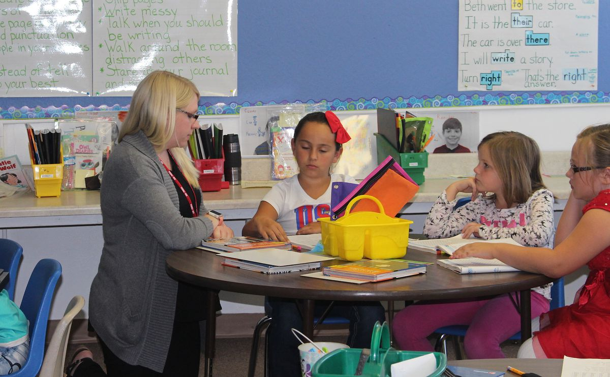 Chelsea Wendorf, who visited La Veta as part of the rural teacher immersion program, helps in a third grade classroom.