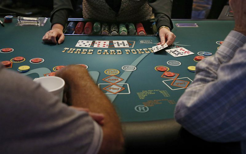 Gamblers play poker in the casino at the WinStar World Casino and Resort in Thackerville, Oklahoma, in 2019.