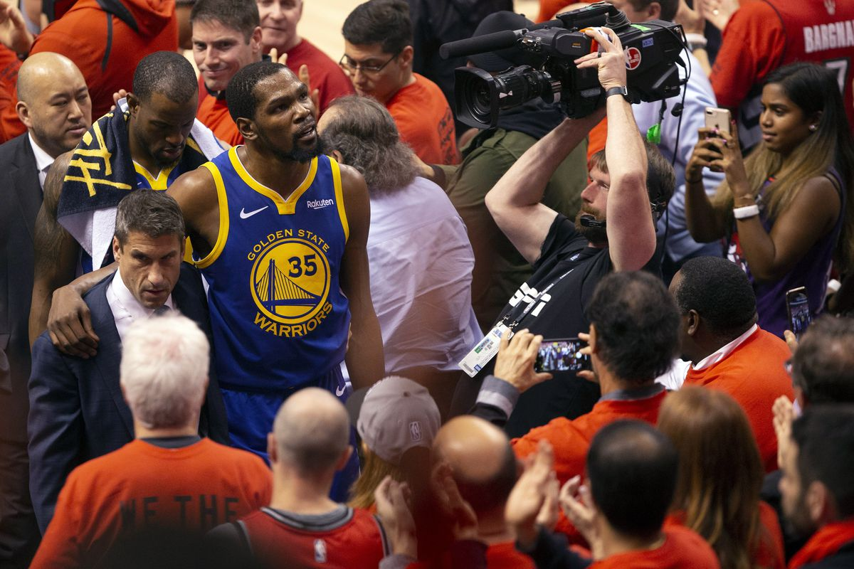 Durant glances up at the stands as he walks off the court after sustaining an injury during first half basketball action in Game 5 of the NBA Finals in Toronto, Monday, June 10, 2019. (Chris Young/The Canadian Press via AP)