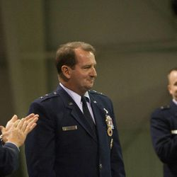 Lt. Gen. Bruce A. Litchfield, left, and Brig. Gen. Carl Buhler, right, clap for Maj. Gen. Brent Baker, Sr. during a change of command ceremony at Hill Aerospace Museum, Monday, Sept. 8, 2014. Buhler assumed command of the Ogden Air Logistics Complex from Baker.