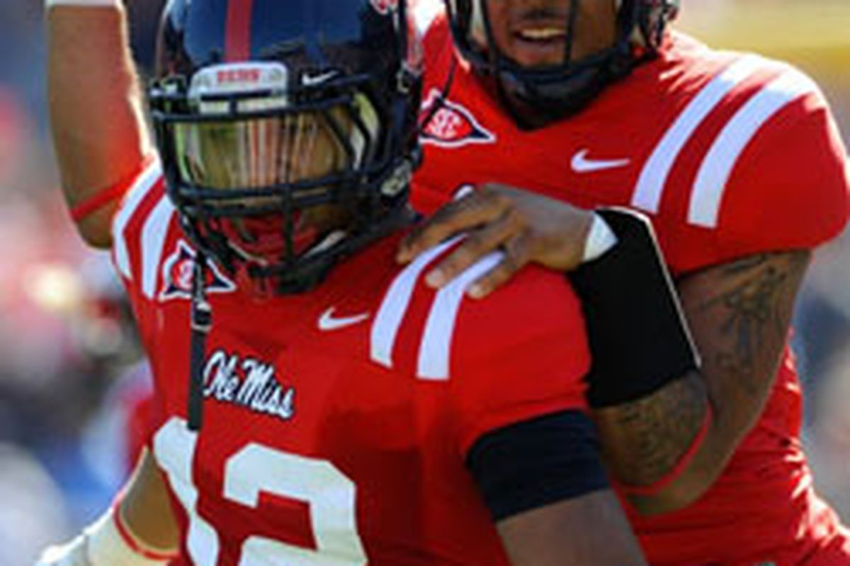 Ole Miss Wide Receiver Donte Moncrief (12) celebrates with Rebel Black Bear's Quarterback Randall Mackey following the first of two touchdown receptions Saturday in the Rebels' 29-24 heart breaker loss to No.10 Arkansas. (Photo by Austin McAfee)