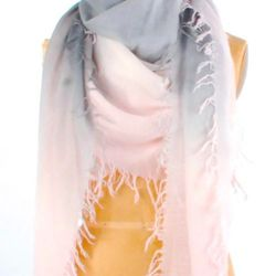 """This Chan Luu scarf ($198, available at the GreenGoddessBoutique.com) is made with natural, organic fibers and the designer's signature """"eyelash fringe."""" When it gets chilly on the plane, """"this is large enough to wrap yourself in,"""" says Rembos. """"It feels"""