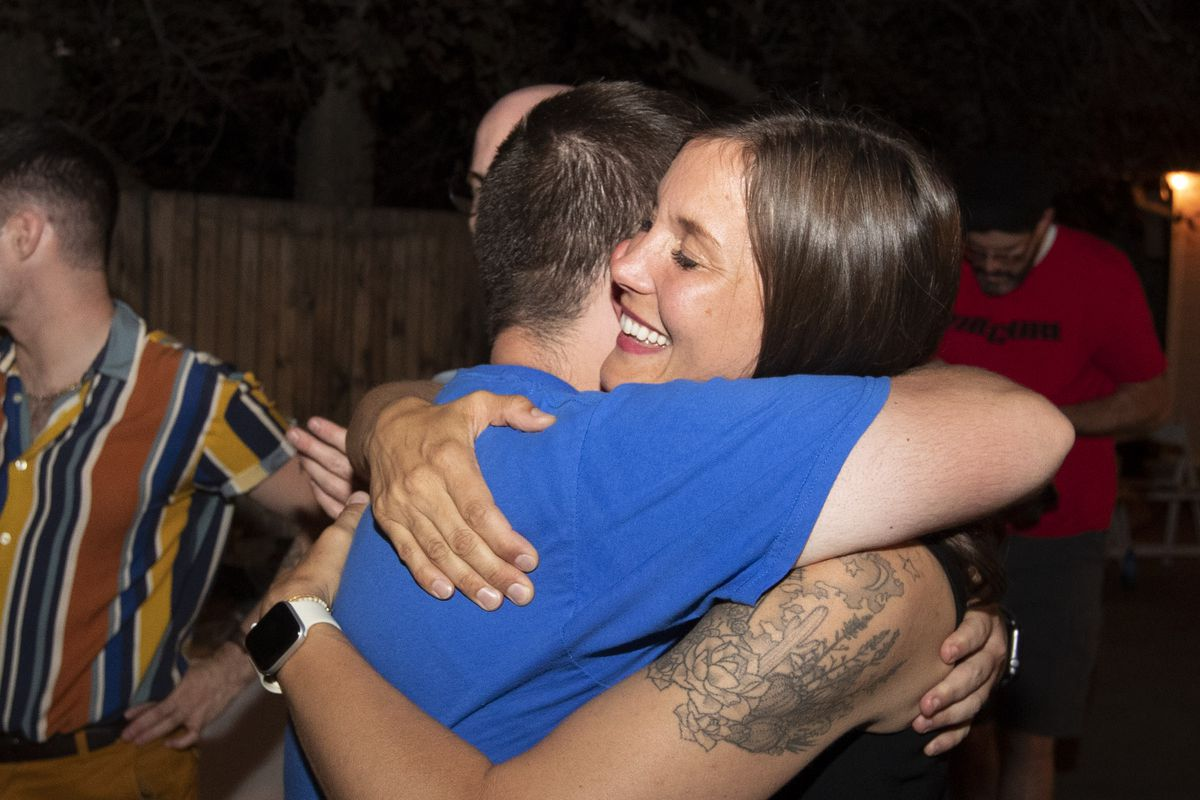 Salt Lake City Councilwoman Erin Mendenhall hugs her campaign manager, Patrick Costigan, during her mayoral primary election night event in Salt Lake City on Tuesday, Aug. 13, 2019. Vote tallies showed her clearly in the lead.