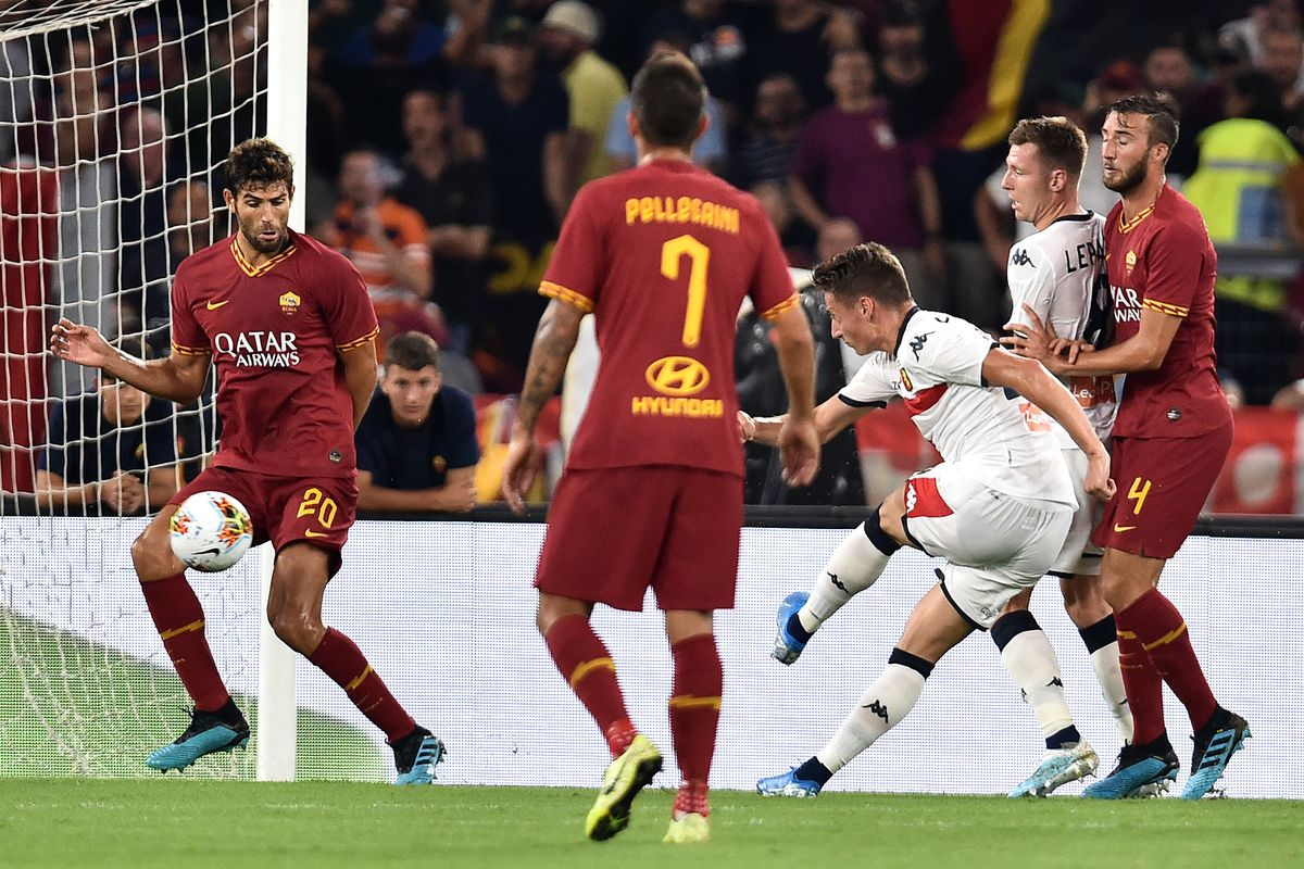 Andrea Pinamonti of Genoa (3L) scores the goal of 1-1 during...