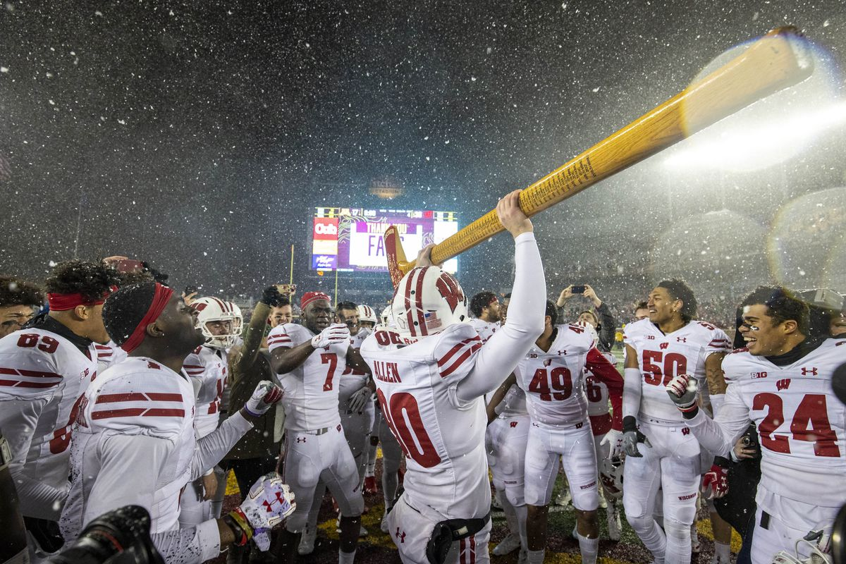 Wisconsin Badgers punter Connor Allen celebrates with the Paul Bunyan Axe Trophy after defeating the Minnesota Golden Gophers at TCF Bank Stadium.