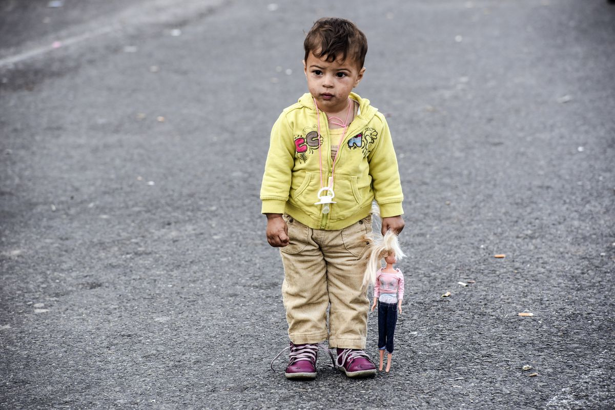 A migrant child on the Serbian side of the Serbia-Hungary border.