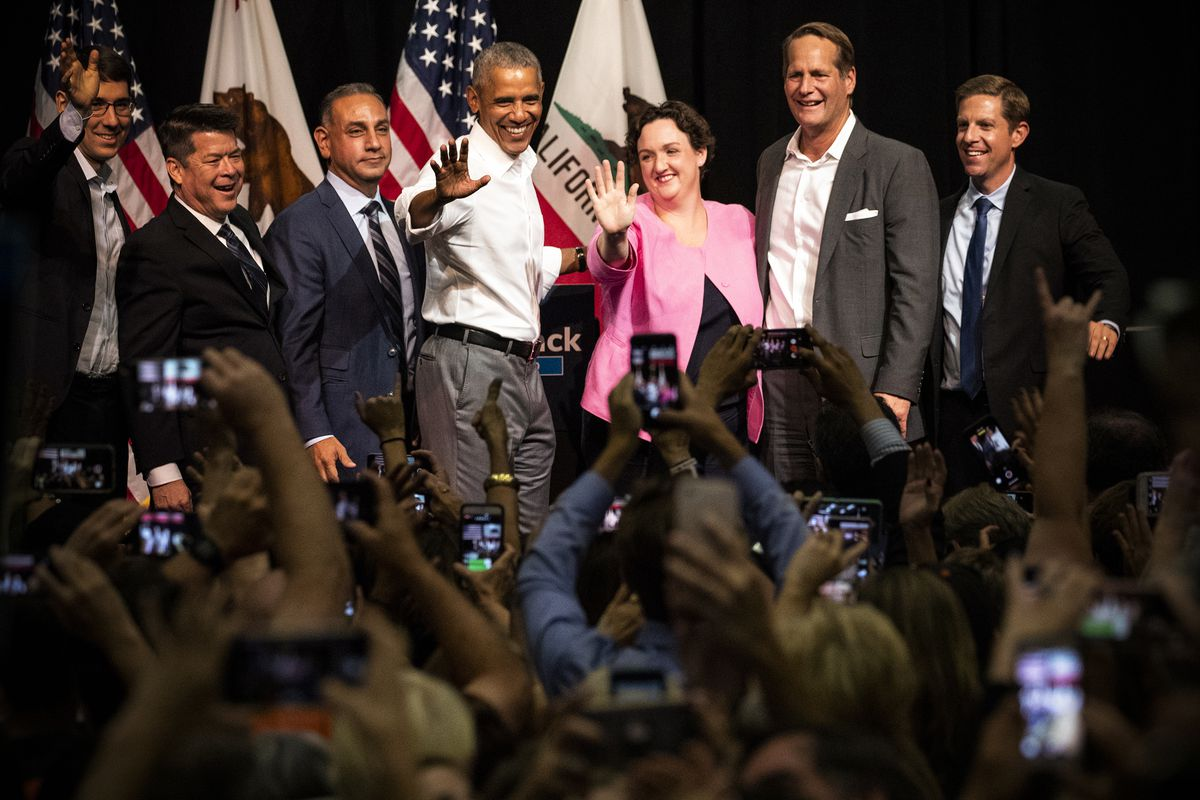 Former President Barack Obama attends a campaign rally with Democratic congressional candidates (left to right) Josh Harder, T.J. Cox, Gil Cisneros, Katie Porter, Harley Rouda, and Mike Levin on September 8, 2018 in Anaheim, California.
