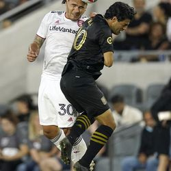 Real Salt Lake defender Marcelo Silva, left, and Los Angeles FC forward Carlos Vela try to head the ball during the first half of a Major League Soccer match Saturday, July 17, 2021, in Los Angeles.