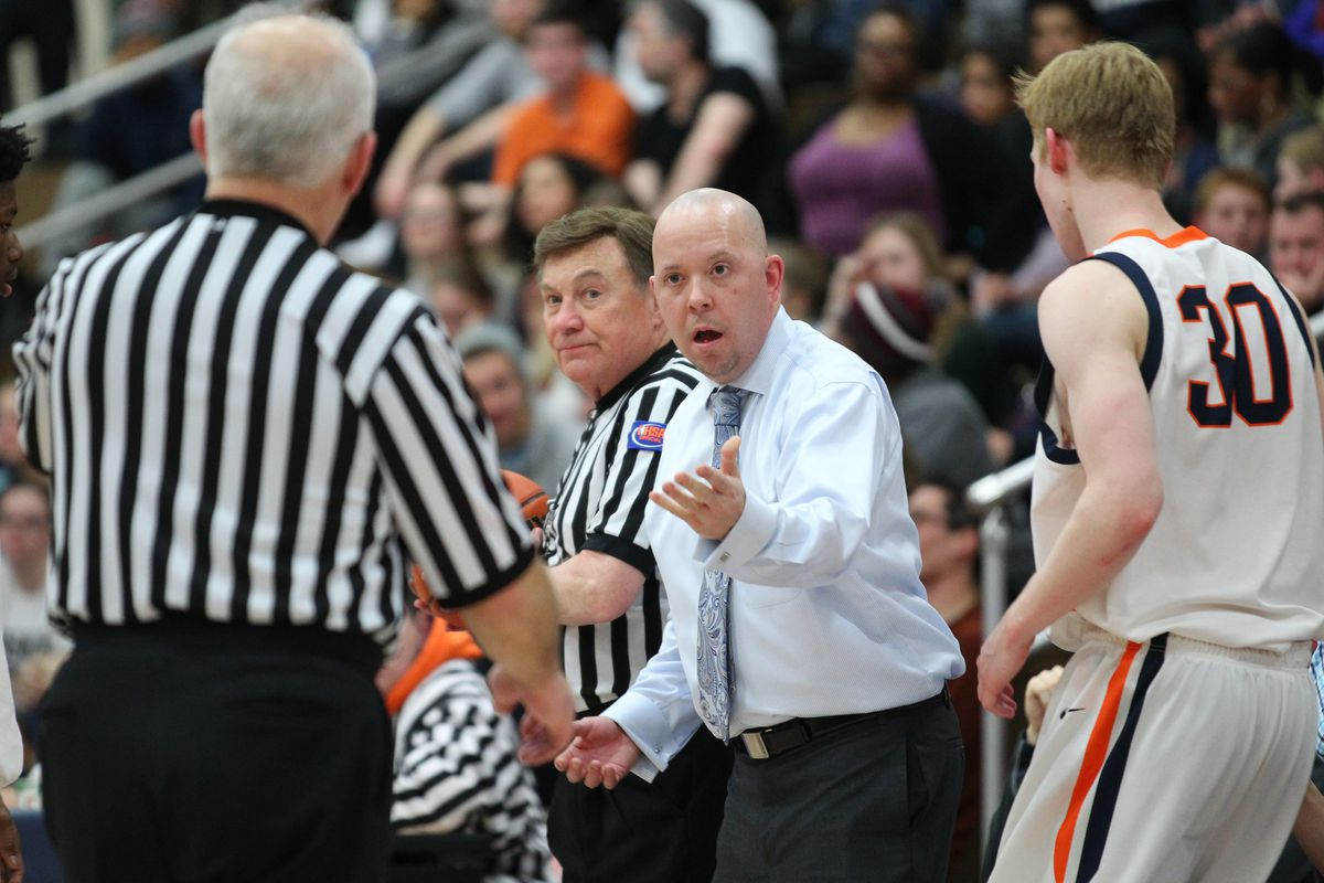 Oak Park basketball coach Matt Maloney argues with a referee during a game against York.