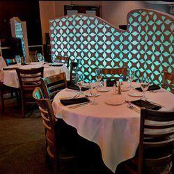 Dining room inside Genesis Steakhouse & Wine Bar.