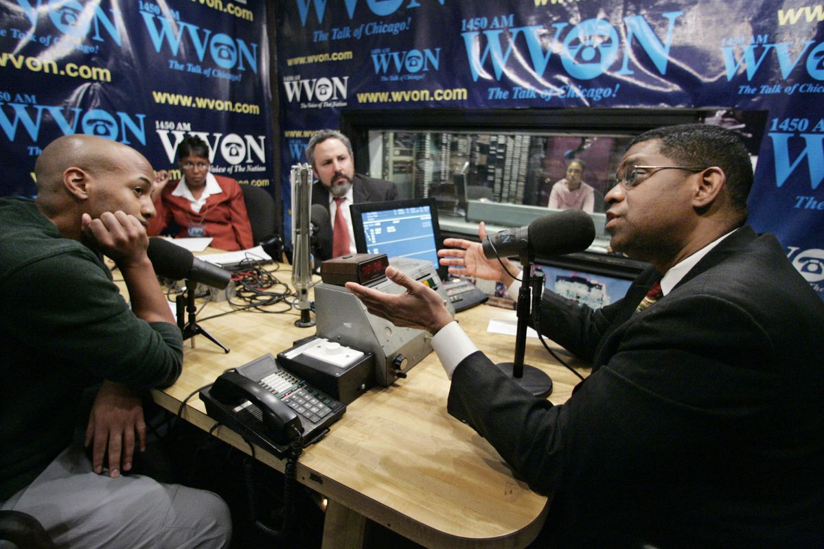 Dr. Terry Mason, right, talks with guests on his WVON radio program in 2006.